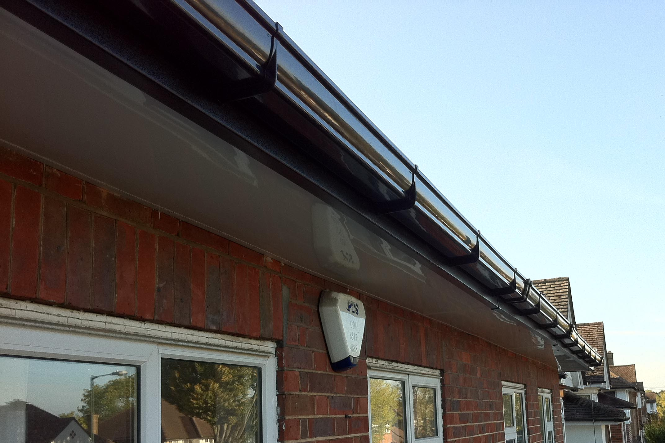 Osma Stormline Guttering Fitted To Upvc Black Wood Effect