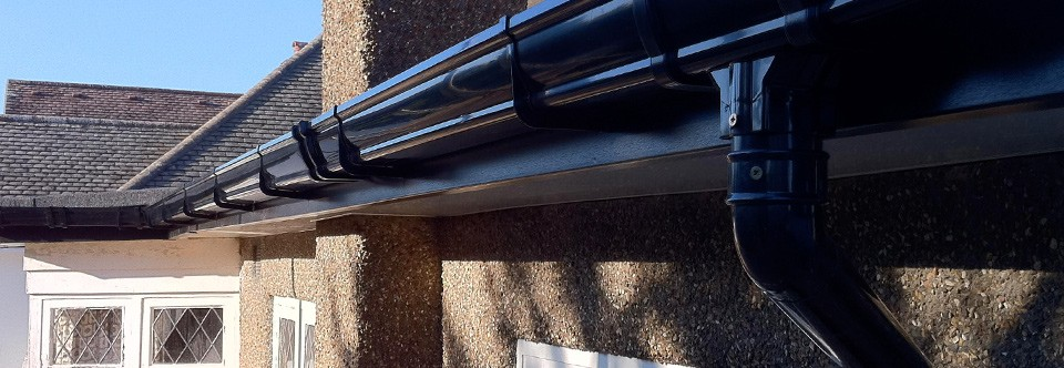 Osma StormLine Guttering fitted to uPVC Black Wood-Effect Fascia
